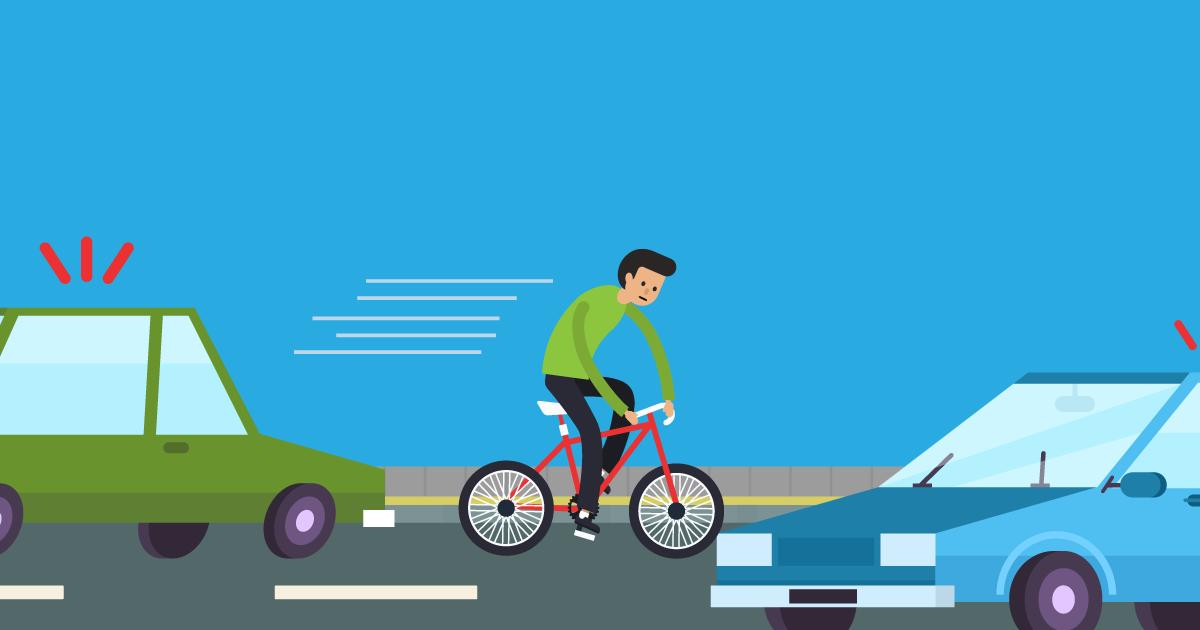 Man riding bike through traffic