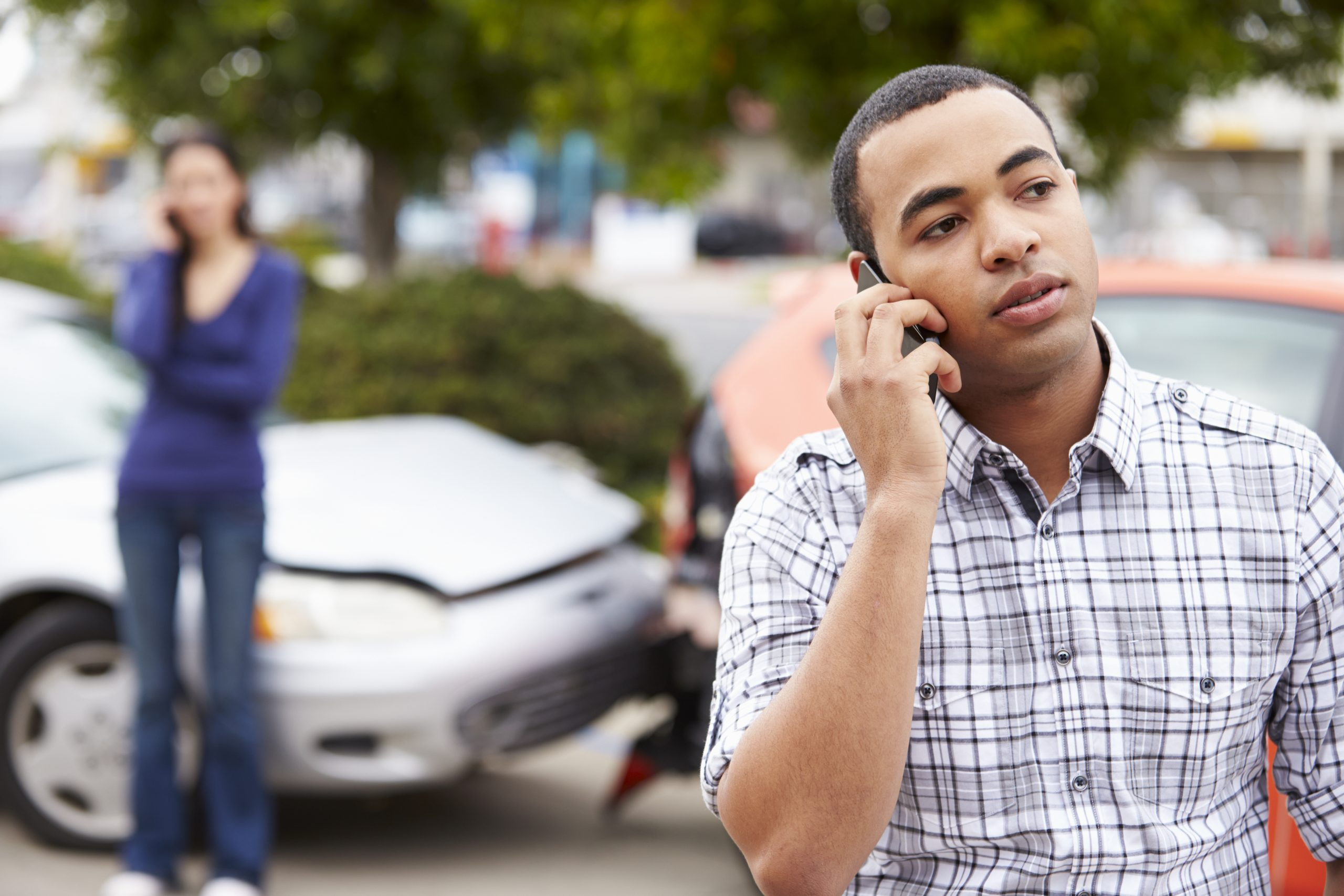 Man on phone at accident scene