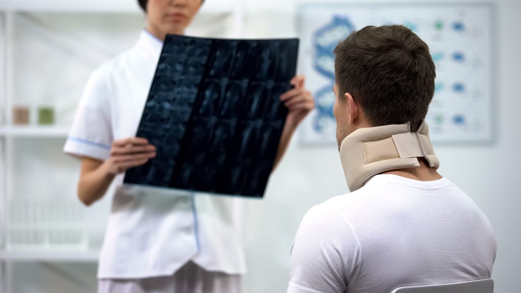 neck pain, Traumatologist,Showing,Neck,Xray,To,Male,In,Foam,Cervical,Collar,